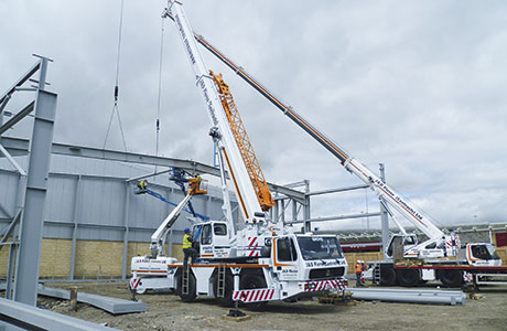 Cranes help firm reach new highs