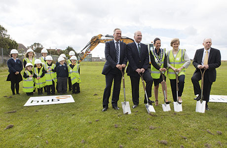 Deputy First Minister Nicola Sturgeon took part in the turf cutting under the watchful eye of pupils.