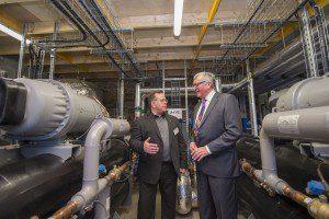 Galashiels, Borders College Campus, Netherdale, UK. 08.12.2015.   First in UK, Heat from Sewage scheme Energy Minister Fergus Ewing, today launched the first SHARC energy recovery system at Borders College Campus, in Galashiels. Part of a 20 year purchase agreement, providing 95% of the campus heating needs. Pictured here with  Russ Burton, CEO of SHARC Energy Systems in the new plant. (Photo: Rob Gray)