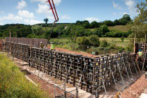 Photography by Roy Riley 0781 6547063 03.07.09 Images of Concrete being poured into formwork from Mabey Hire who supply modular concrete formwork for the construction of a reinforced concrete retaining wall as part of a social housing development in Newton Abbott, Devon