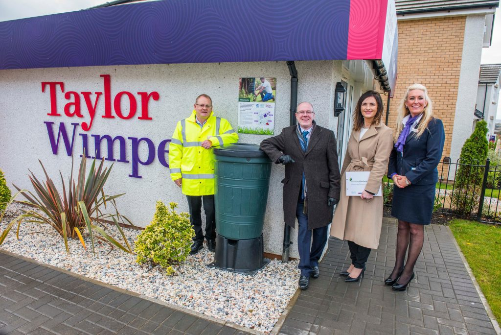(L-R) Minister for Local Government and Housing, Kevin Stewart with Willie Burns MD, Audrey Ross and Angela Curran of Taylor Wimpey West Scotland