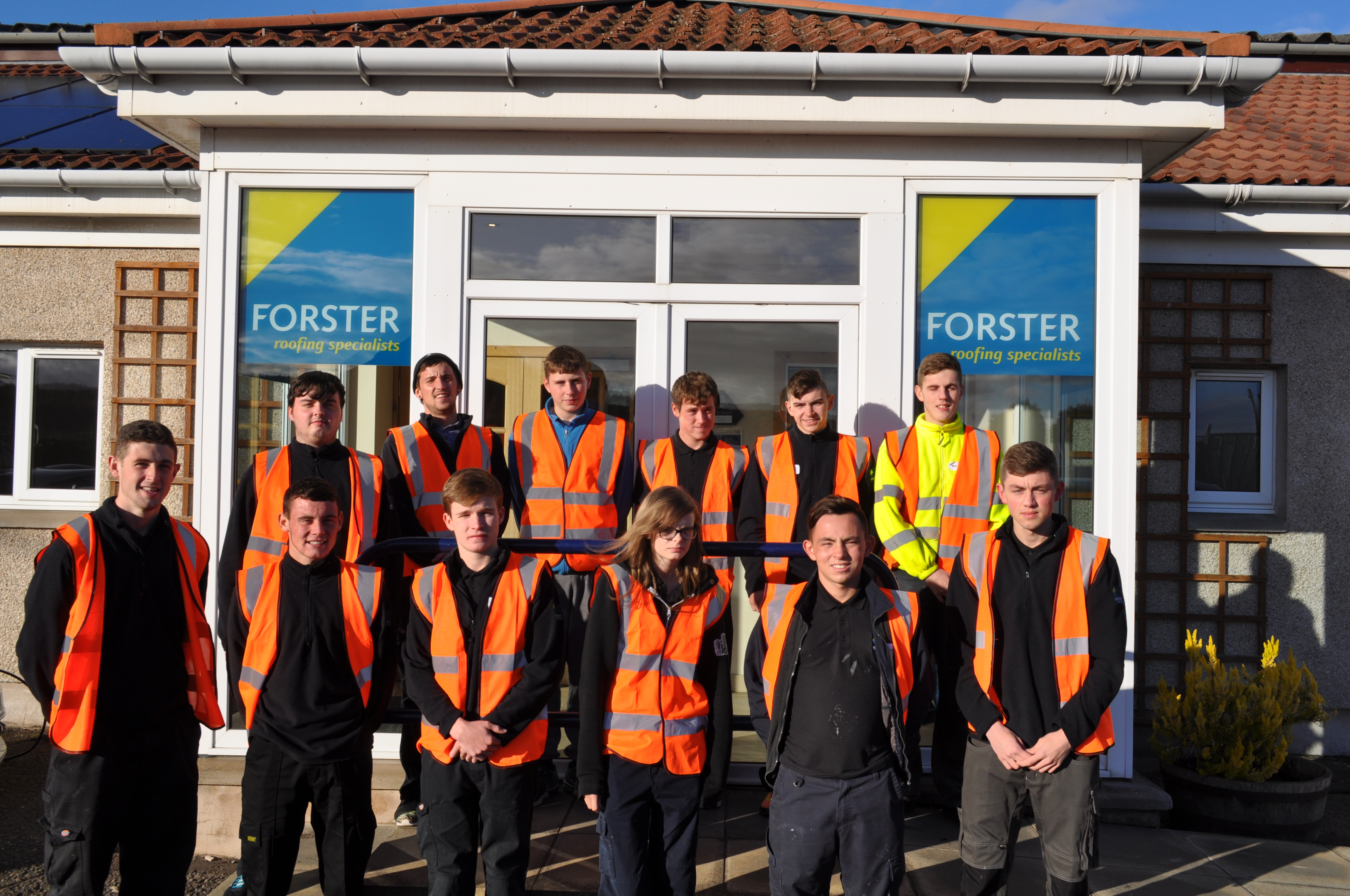 eleven-of-the-twelve-new-roofing-apprentices-outside-forster-group-headq